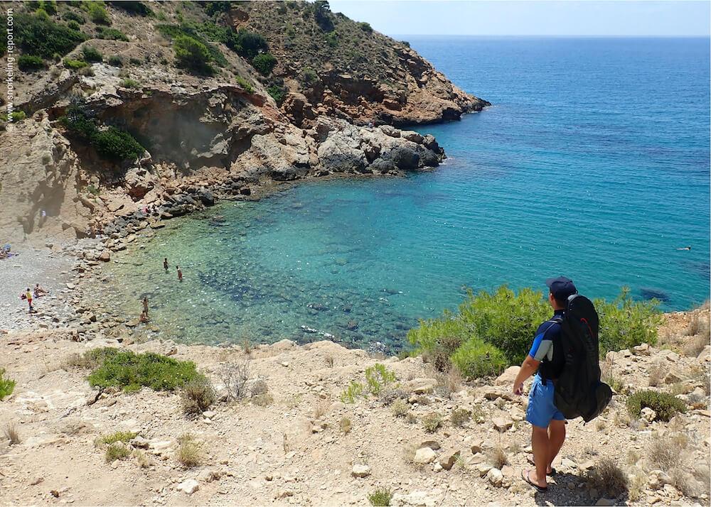 Snorkeler overlooking a rocky bay