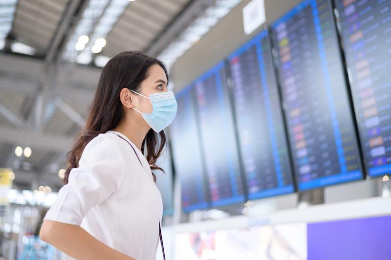Woman in an airport wearing mask