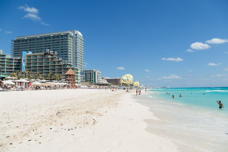 Cancun, Zona Hotelera, Quintana Roo. Mexico. April 2, 2019: The popular resort of Mexico is Cancun. White beaches and beautiful Caribbean Sea. Big luxury hotels on the Caribbean