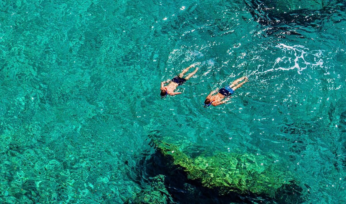 Snorkelers in crystal sea