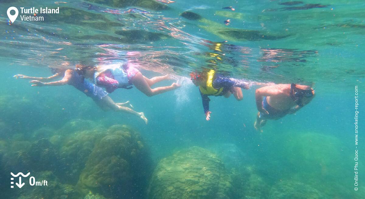Snorkelers in Doi Moi Island